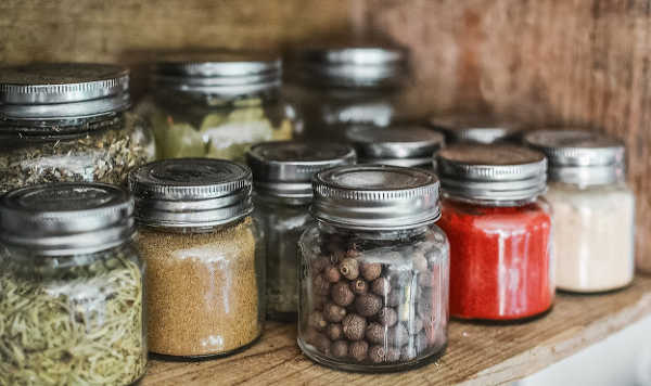 small glass jars of herbs and spices